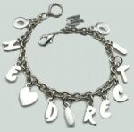 ONE DIRECTION silver coloured alloy charm bracelet. HOT! NEW!